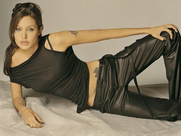 Angelina Jolie Cross Tattoo