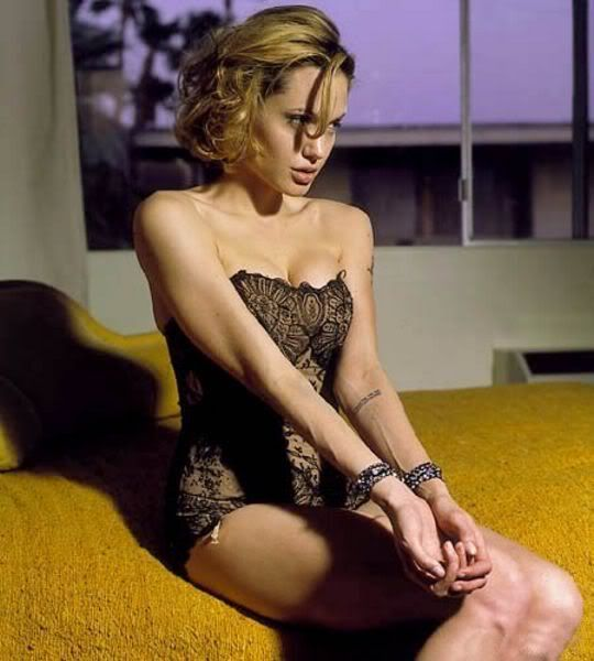 Angelina Jolie Left Arm Tattoo Tennessee Williams