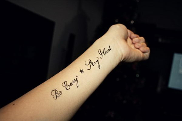 Lower arm quote tattoos