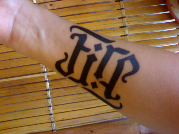 fire ambigram tattoo on arm 38