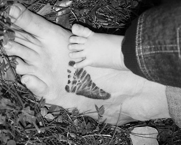 19 little feet tattoo