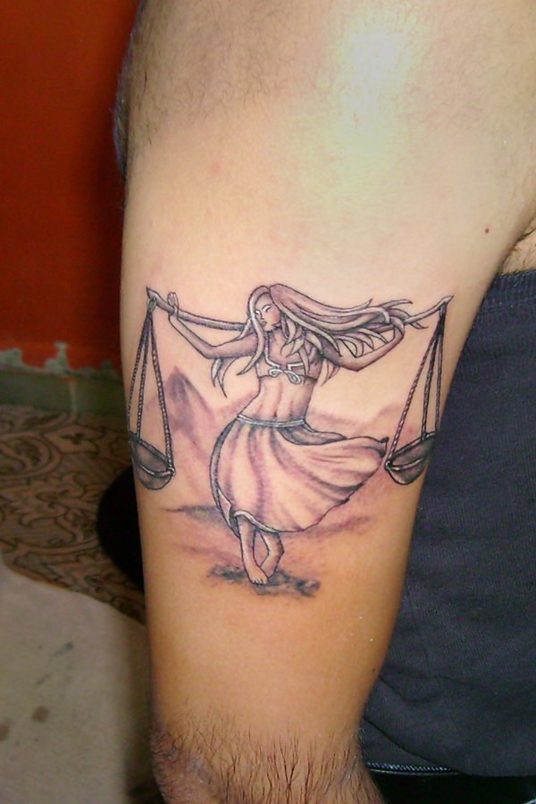 23 libra tattoo on arm