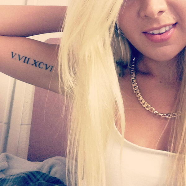 11 roman numerals on girls arm