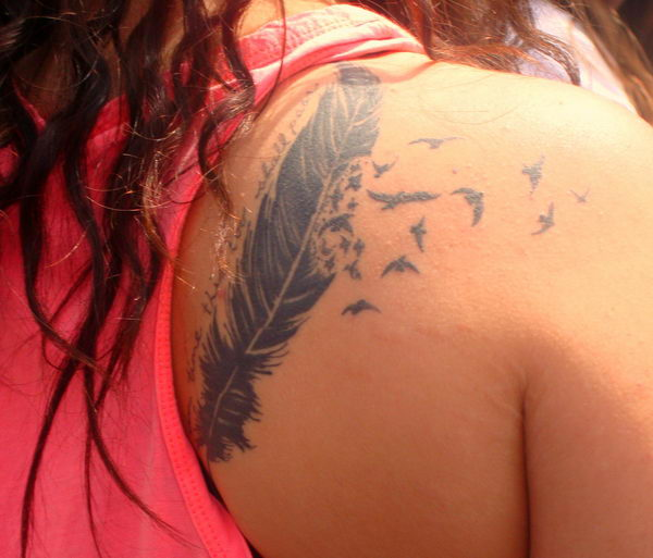 1 feather and birds on shoulder blade
