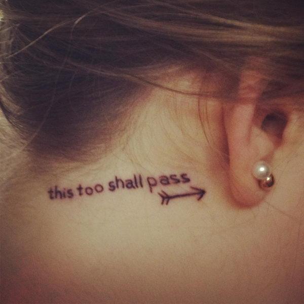 18 behind ear tattoo with an arrow