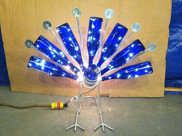 This peacock wine bottle holder with lights is a great Christmas gift.
