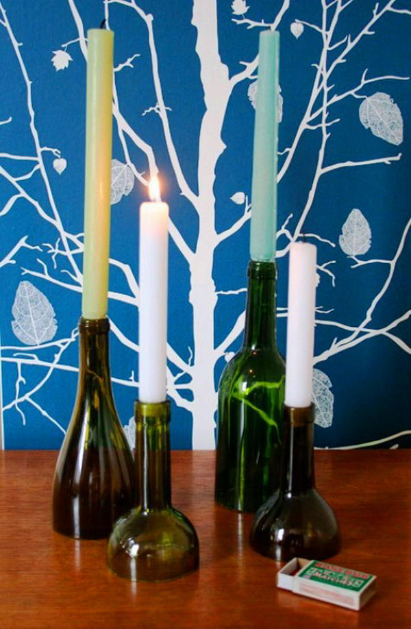 DIY Wine Bottle Candle Holders. Cut the wine bottles at different heights to create these cool candle holders. They are perfect for dinner decoration!