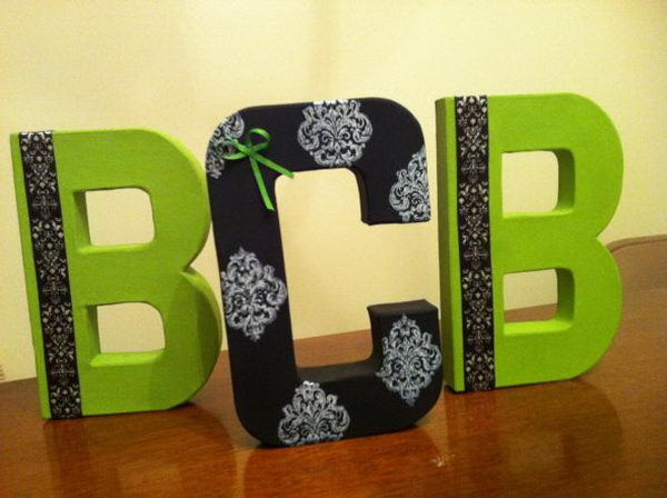 black and green cardboard letters