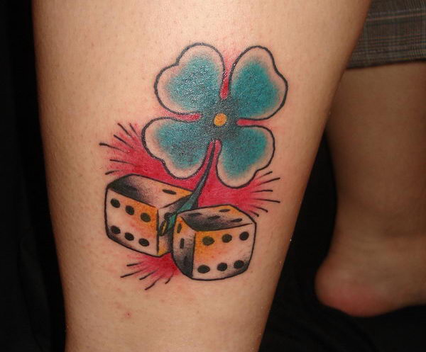 10 four leaf clover and dice on leg