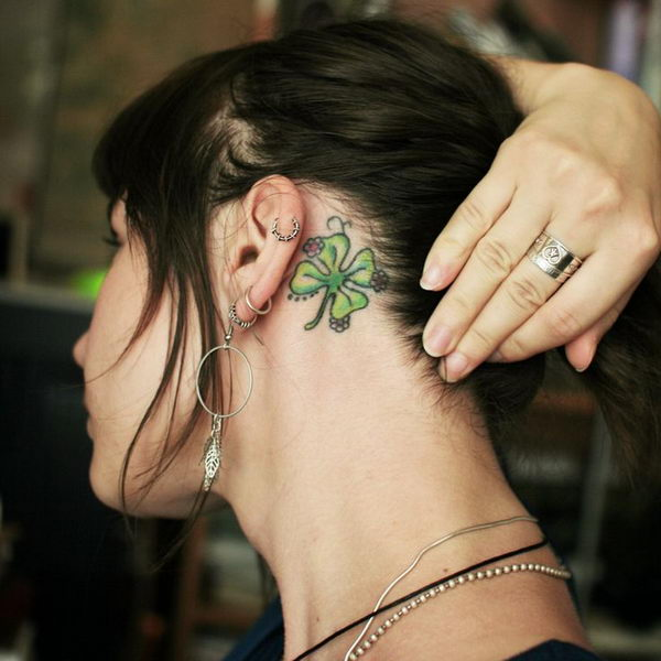 19 lucky tattoo behind the ear