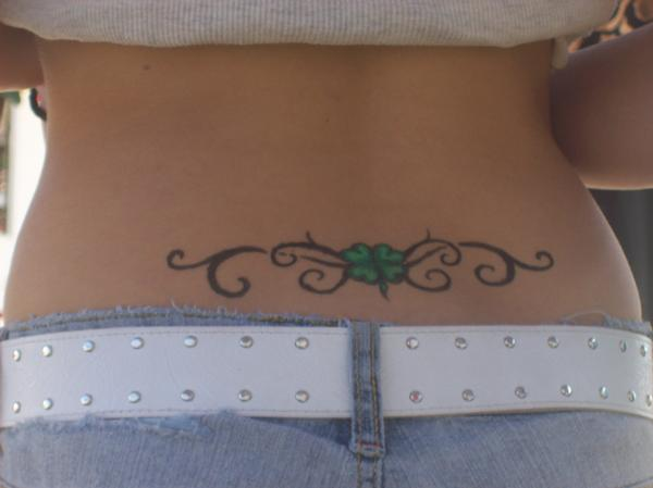 27 tribal clover on lower back
