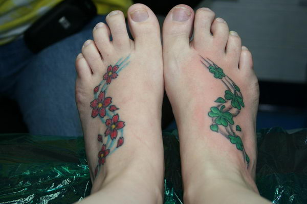 3 blossoms and clovers on feet