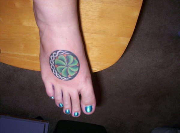 4 four leaf clover on foot
