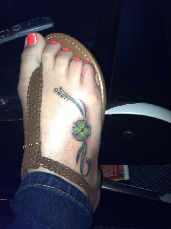 7 four leaf clover on foot