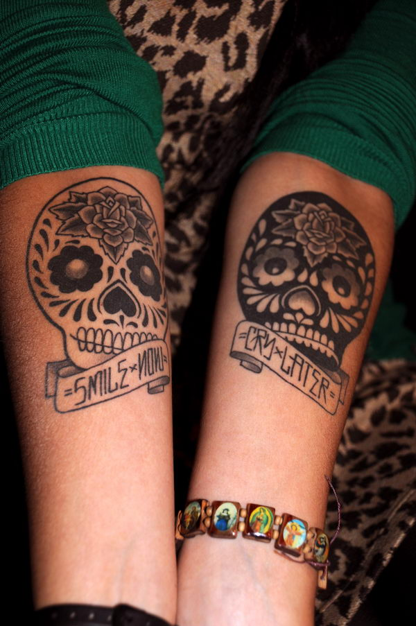10 skulls arm tattoo