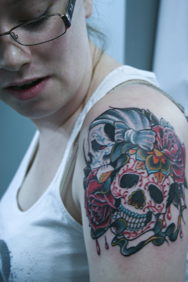 9 sugar skulls on shoulder