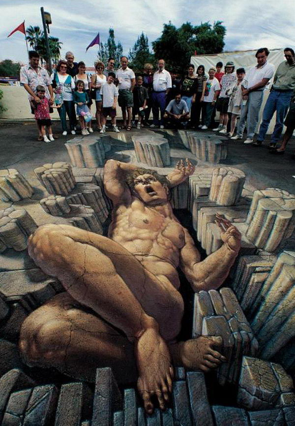 3D Street Art Relaxing giant. A huge giant relaxing on the street.