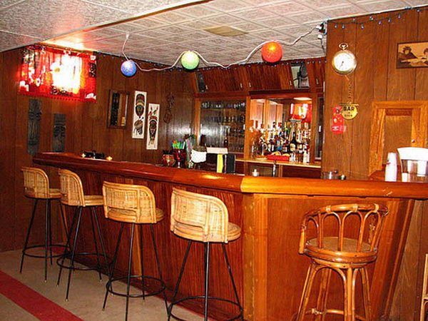 Wooden Basement Bar. It is created with wood taken from a destroyer ship called the Vance. The previous owner did an amazing job of constructing this bar with teak from the ship throughout.