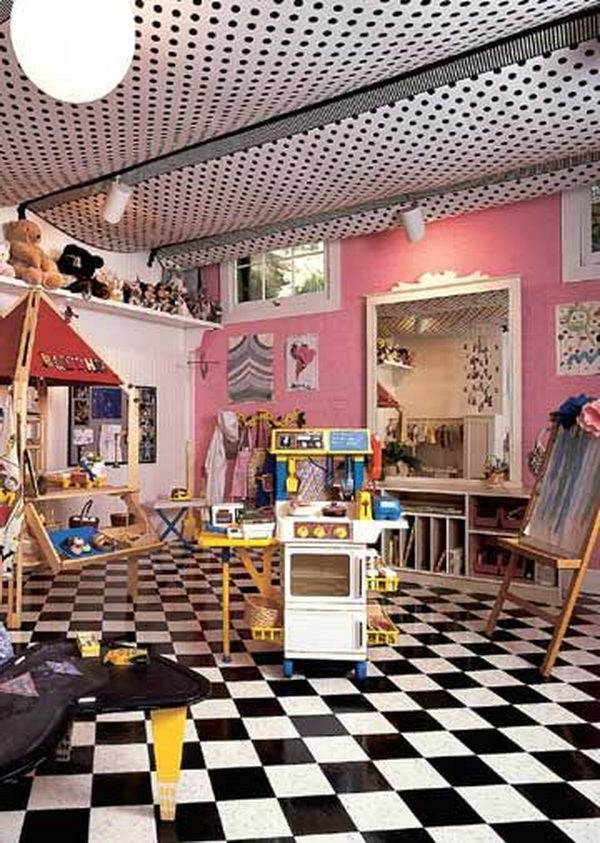 Tented Ceiling Playroom in basement created by stapling fabric panels to exposed floor joists.