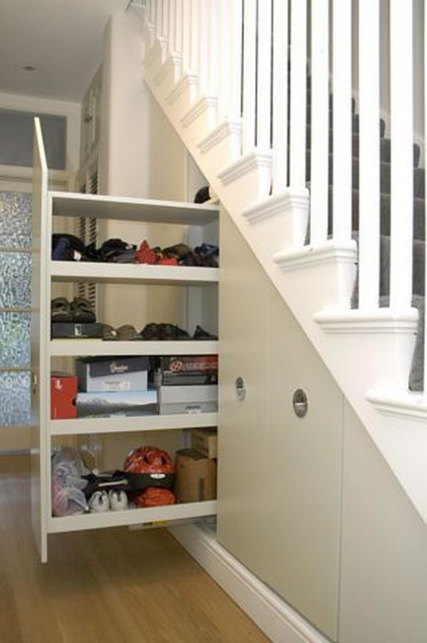 Pull out Storage Under Stairs. Tall broom cupboard with pull out under stairs storage.