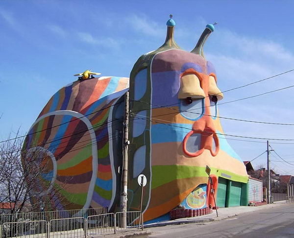 Snail House (Sofia, Bulgaria). The snail house was built with high quality of lightweight and environmentally friendly materials in 2008. The house fits well with the neighboring constructions and producing the illusion that the gigantic snail crawl along the lane. producing the illusion that the gigantic snail crawl along the lane.