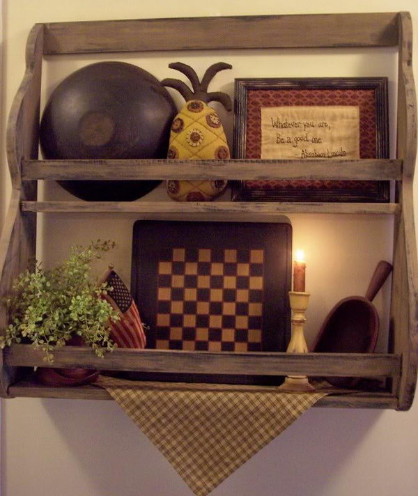 Primitive Shelf Decor. Mix a gameboard with a antique bowl, sampler and more to add an interest to a shelf. The mix of color and texture is great.