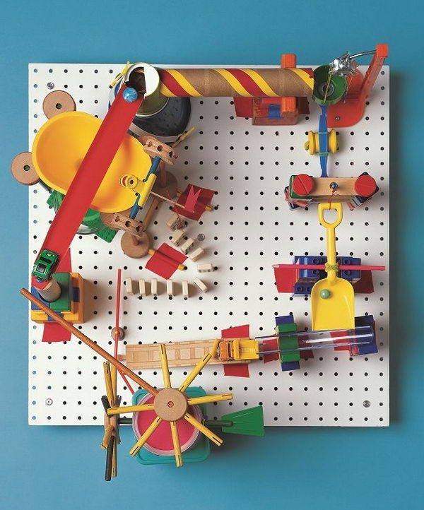 DIY Marble Run Craft, This peg board marble run involves creating a clacking, whacking gumball machine that runs without electricity, all with parts found in the kitchen and toy box. A complete operation tutorial was provided.