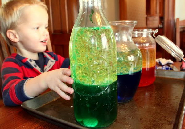 Lava Lamp Science Experiment for Kids. The Alka Seltzer reacts to make the Carbon dioxide bubbles. The bubbles stir the oil and colored water together.