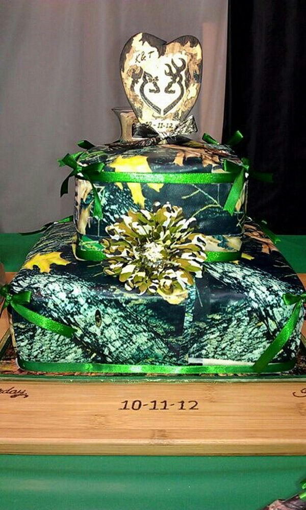 Camouflage Wedding Cake With An Orange Flower And Ribbon