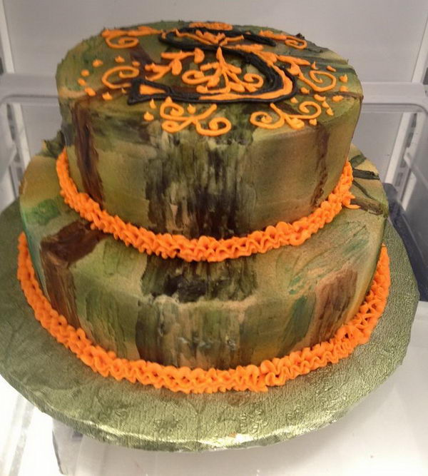 Camouflage Wedding Cake With Initial Piped In Frosting On Top Tier