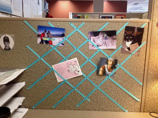 you can pin ribbon to the wall of the cubicle for a decorative photo collage 1 - Cubicle Design Ideas