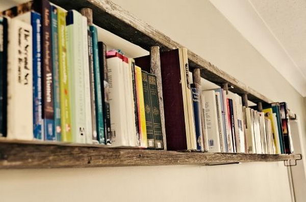 Hamg a ladder horizontally on the wall as a book shelf.