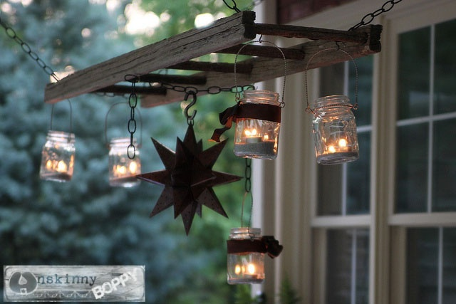 Hang mason jar lights on ladder as a cute vintage lantern hanger.