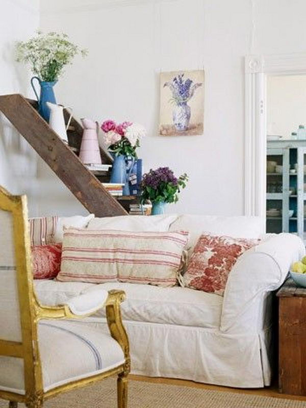 This old ladder was used as a lovely display shelf behind a couch.