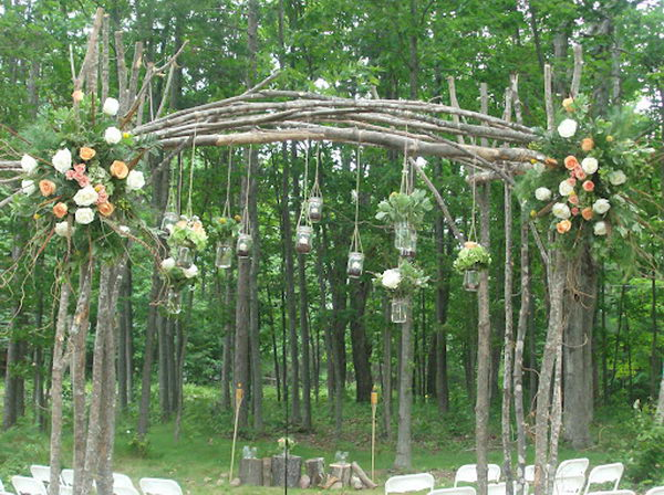 Mason Jars Wedding Arch. Hanging mason jars with candles and flowers is a great inexpensive idea for an outdoor wedding.