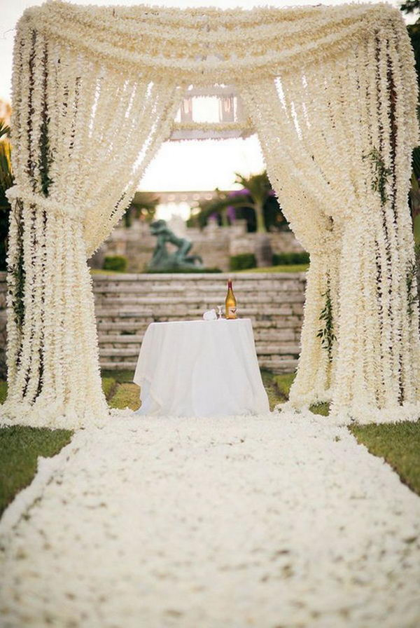 Chuppah With Chains Of White Flowers.