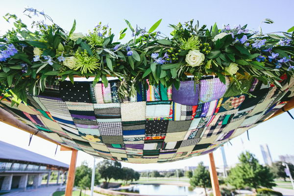 Quilted Chuppah. The chuppah canopy is a quilt that was made with clothes collected from the bride mother's closet. It's a tribute to the bride's mother who tragically passed away just as she was embarking on her wedding planning.