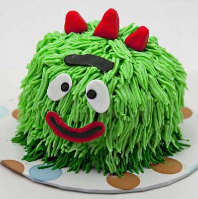 A Yo Gabba Gabba Cakee with vanilla icing in the shape of Brobee with icing hair and fondant details.