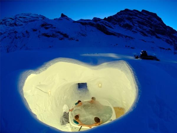 Iglu Dorf Hotel in Switzerland. Built from scratch every winter, it takes almost 3000 tons of snow to create each Igloo. Standard village consists of Igloo Hotel, Igloo Bar, series of tunnels, and smaller Igloos that serve as private rooms.