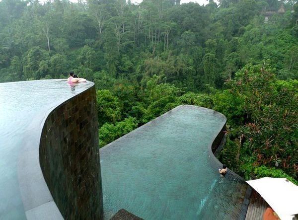 Ubud Hanging Gardens Hotel in Bali. This hotel has a towering, multi leveled infinity pool that looks like a natural cliffside and was in fact designed to mimic the surrounding hills. In addition to the two main pools, each of the 38 guest rooms at Ubud has its own mini infinity pool with views of the nearby Pura Penataran Dalem Segara temple.