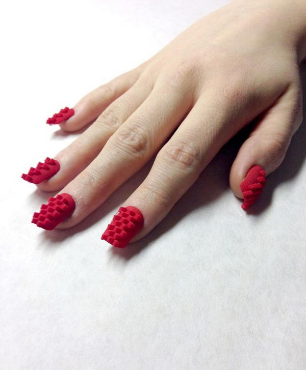 Red 3D Printed Nail Art, 3D nail art is a technique for decorating nails that creates three dimensional designs.