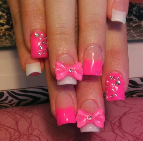 Pink Nails With 3D Bow and Rhinestones, 3D nail art is a technique for decorating nails that creates three dimensional designs.