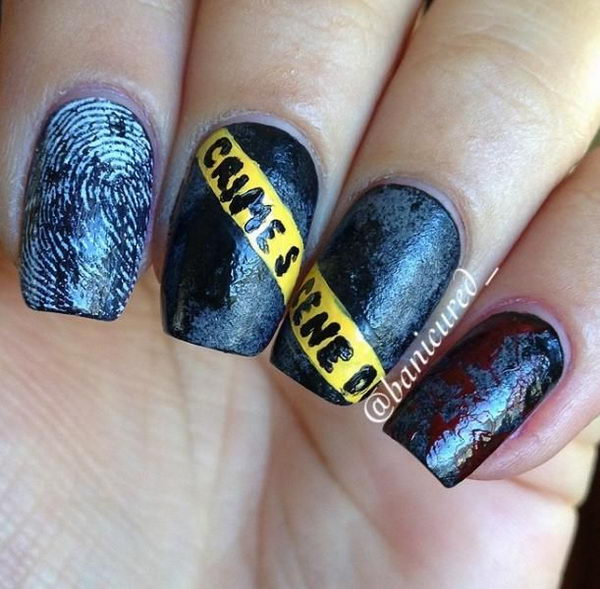 Caution Tape Crime Scene Nails. Cool Halloween Nail Art which show off your spooky spirit during the freakish festivities.