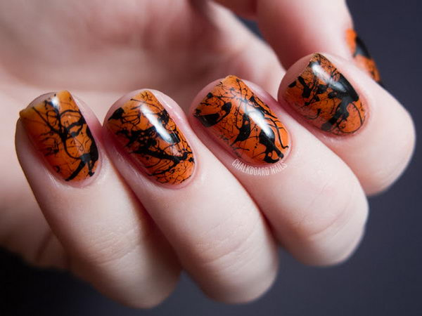 Spooky Splatter Nails. Cool Halloween Nail Art which show off your spooky spirit during the freakish festivities.