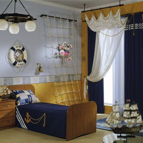 There are so many different options when it comes to decorating a nautical themed room. Boats, ships, sailors, nautical flags, treasure map, pirates, sea animals, sea shells, lighthouses, palm trees, tropical beach, surf shack, seaside cottage style, rustic cabin style and toddlers. Bring a maritime feel to your little boy's bedroom with one of these ideas right now.