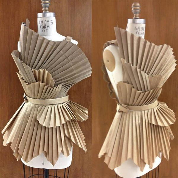 Grocery Bag Recycled Dress. There is no easier costume than a paper bag mask. Grab a paper bag and cut out holes for your eyes then grab a few markers and let your imagination go wild. They are so simple for kids to make and to wear.