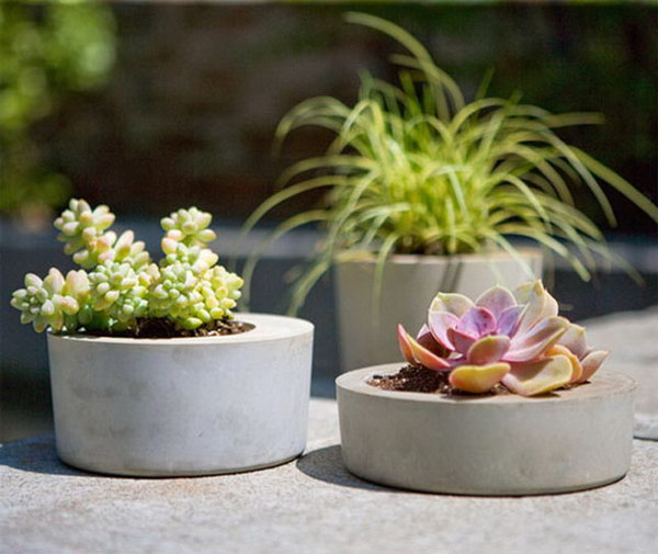 Modern Concrete Planters. Concrete isn't just for the infrastructure and base of certain buildings. You can use concrete in a variety of DIY projects, and infuse it into everyday products.