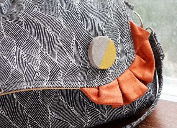 DIY Cement Brooches on a Handbag. Concrete isn't just for the infrastructure and base of certain buildings. You can use concrete in a variety of DIY projects, and infuse it into everyday products.