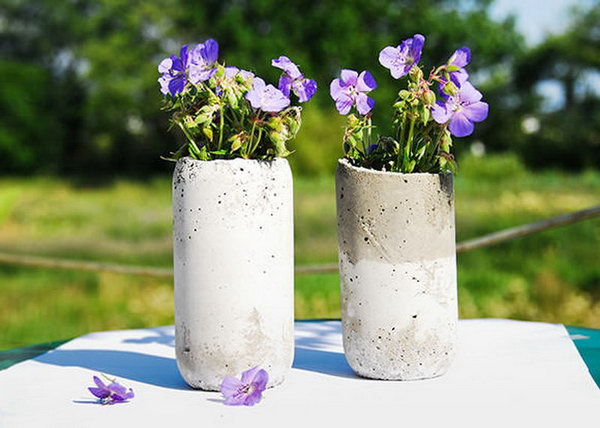 DIY Concrete Vases. Concrete isn't just for the infrastructure and base of certain buildings. You can use concrete in a variety of DIY projects, and infuse it into everyday products.