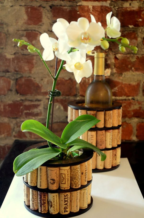 Recycled wine cork vase. These container gardening ideas offer a great way to brighten your surroundings immediately. Make your home look different unique and interesting.